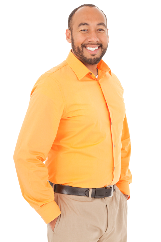Man in button up smiling in front of white background.